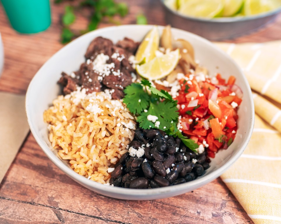 Steak bowl from LIME Fresh Mexican Grill with cilantro, rice, beans, and pico de gallo