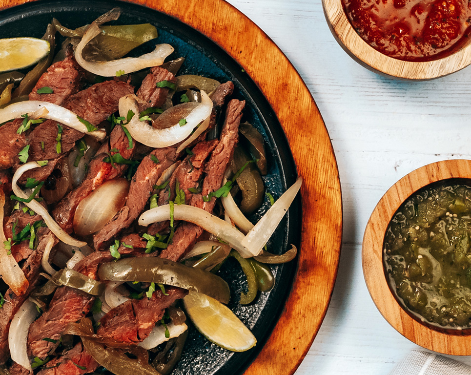 Steak fajitas with side sauces